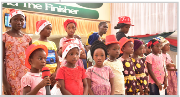 Children from the Chapel's Missionary Field during their Bible recitations at the Carol.