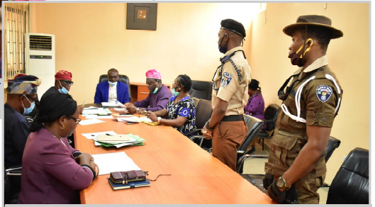 Odeda Area Commander of Man 'O' War, Comrade Charles Geteloma (Standing, 2nd Right) addressing the Vice-Chancellor, Prof. Kolawole Salako (Centre) and other Principal Officers of the University.