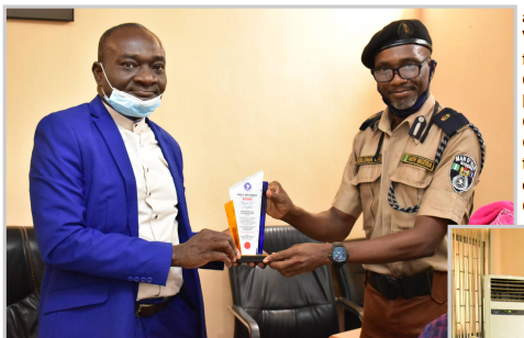Vice-Chancellor, Prof. Kolawole Salako (Left) receiving an Award of Excellence from the Odeda Area Commander of Man 'O' War, Comrade Charles Geteloma.